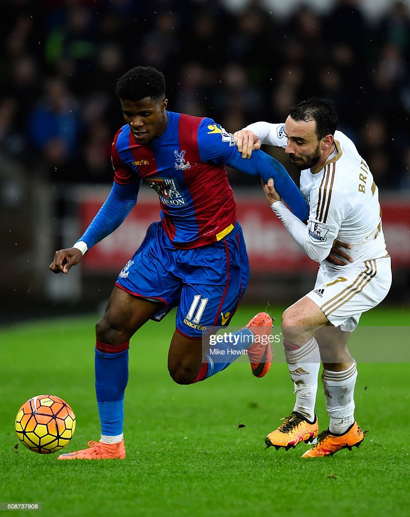 Wilfried Zaha of Crystal Palace and Leon Britton of Swansea City compete for the ball during the Barclays Premier League match between Swansea City and Crystal Palace at the Liberty Stadium on February 6, 2016 in Swansea, Wales.