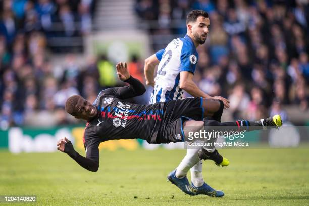 Wilfried Zaha of Crystal Palace and Martin Montoya of Brighton Hove Albion in action during the Premier League match between Brighton Hove Albion and...