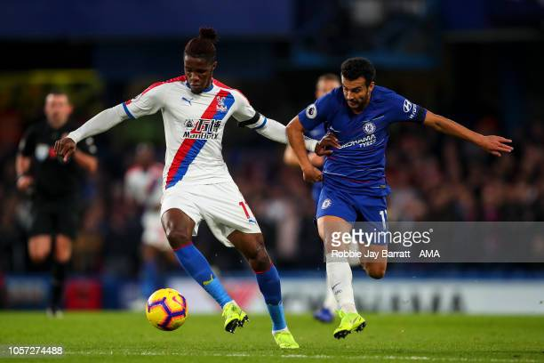 Wilfried Zaha of Crystal Palace and Pedro of Chelsea during the Premier League match between Chelsea FC and Crystal Palace at Stamford Bridge on...