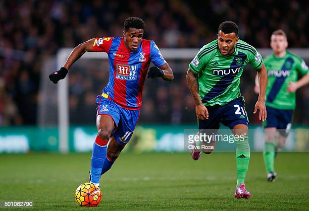Wilfried Zaha of Crystal Palace and Ryan Bertrand of Southampton compete for the ball during the Barclays Premier League match between Crystal Palace...