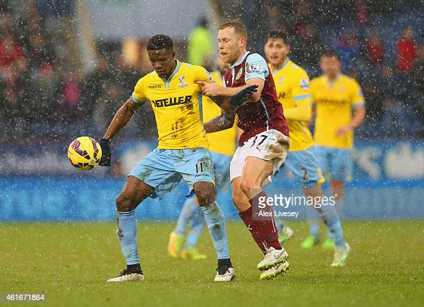 Wilfried Zaha of Crystal Palace and Scott Arfield of Burnley battle for the ball during the Barclays Premier League match between Burnley and Crystal...