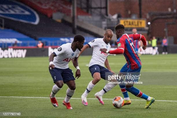 Wilfried Zaha of Crystal Palace and Serge Aurier Lucas Moura of Tottenham Hotspur in action during the Premier League match between Crystal Palace...