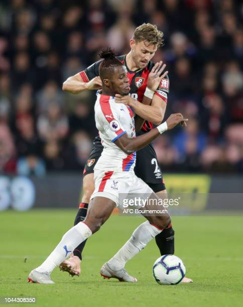 Wilfried Zaha of Crystal Palace and Simon Francis of Bournemouth get to grips with each other during the Premier League match between AFC Bournemouth...