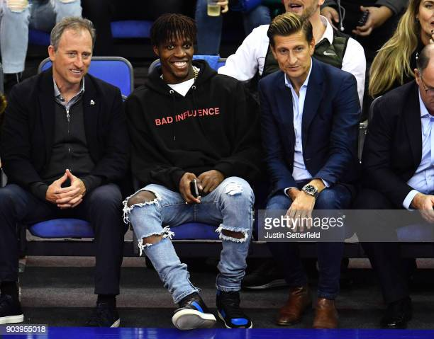 Wilfried Zaha of Crystal Palace and Steve Parish Chairman of Crystal Palace during the NBA game between Boston Celtics and Philadelphia 76ers at The...