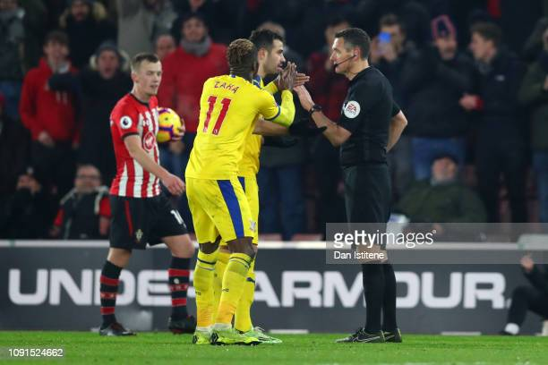 Wilfried Zaha of Crystal Palace applauds Match Referee Andre Marriner after being shown a yellow card which leads to his sendingoff during the...