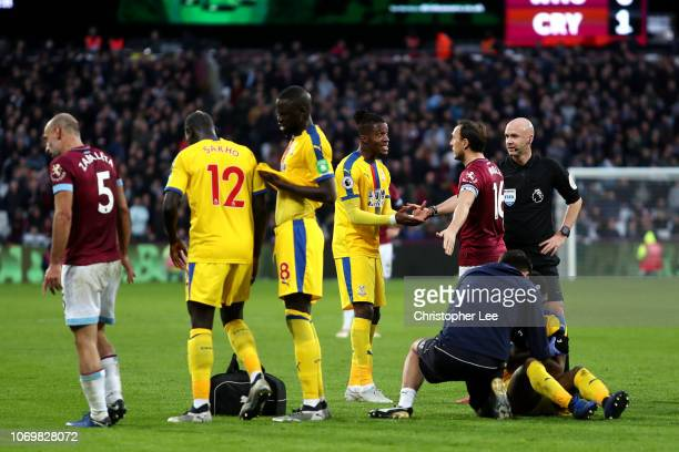 Wilfried Zaha of Crystal Palace argues with Mark Noble of West Ham United during the Premier League match between West Ham United and Crystal Palace...