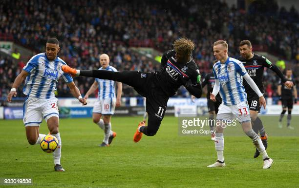 Wilfried Zaha of Crystal Palace attempts a volley during the Premier League match between Huddersfield Town and Crystal Palace at John Smith's...