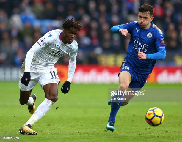 Wilfried Zaha of Crystal Palace attempts to get past Ben Chilwell of Leicester City during the Premier League match between Leicester City and...