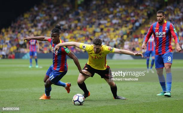 Wilfried Zaha of Crystal Palace battles for possesion with Craig Cathcart of Watford during the Premier League match between Watford and Crystal...