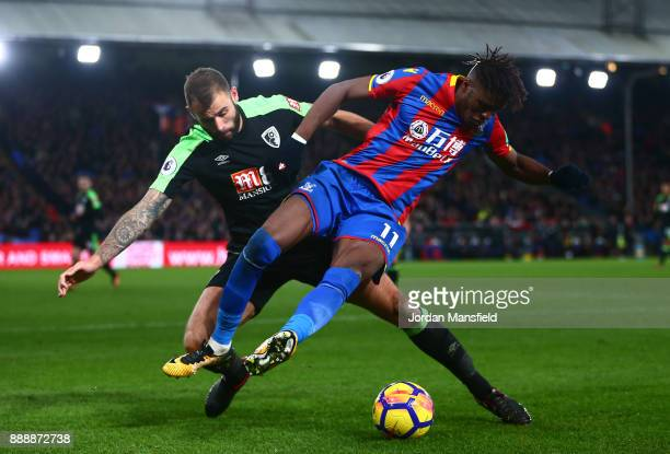 Wilfried Zaha of Crystal Palace battles for possesion with Steve Cook of AFC Bournemouth during the Premier League match between Crystal Palace and...
