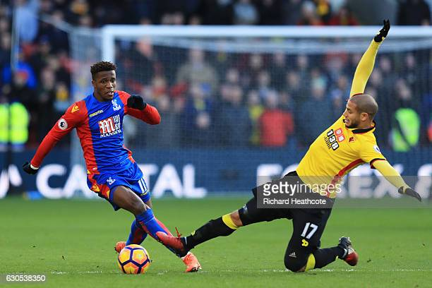 Wilfried Zaha of Crystal Palace battles for the ball with Adlene Guedioura of Watford during the Premier League match between Watford and Crystal...