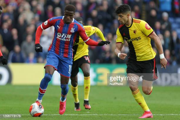 Wilfried Zaha of Crystal Palace battling for possession with Adam Masina of Watford during the Premier League match between Crystal Palace and...