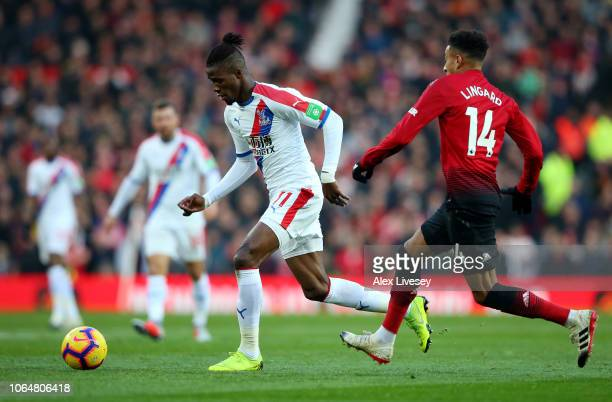 Wilfried Zaha of Crystal Palace breaks away from Jesse Lingard of Manchester United during the Premier League match between Manchester United and...