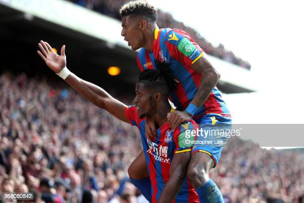 Wilfried Zaha of Crystal Palace celbrates with Patrick van Aanholt of Crystal Palace after scoring his sides first goal during the Premier League...