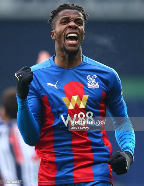 Wilfried Zaha of Crystal Palace celebrates after crossing the ball forcing Darnell Furlong of West Bromwich Albion to put the ball into his own net...