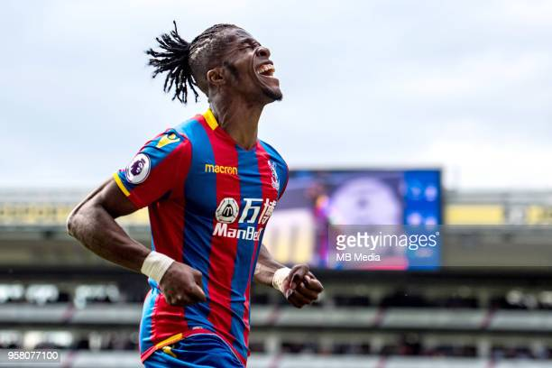 Wilfried Zaha of Crystal Palace celebrates after scoring a goal during the Premier League match between Crystal Palace and West Bromwich Albion at...