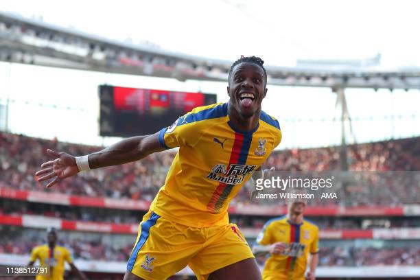 Wilfried Zaha of Crystal Palace celebrates after scoring a goal to make it 21 during the Premier League match between Arsenal FC and Crystal Palace...
