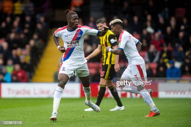 Wilfried Zaha of Crystal Palace celebrates after scoring goal during the Premier League match between Watford FC and Crystal Palace at Vicarage Road...