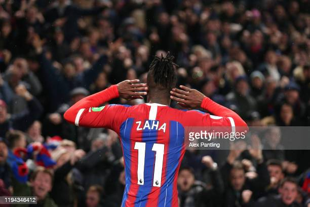 Wilfried Zaha of Crystal Palace celebrates after scoring his sides first goal during the Premier League match between Crystal Palace and Brighton &...