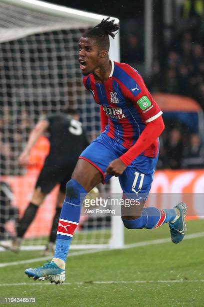 Wilfried Zaha of Crystal Palace celebrates after scoring his sides first goal during the Premier League match between Crystal Palace and Brighton...