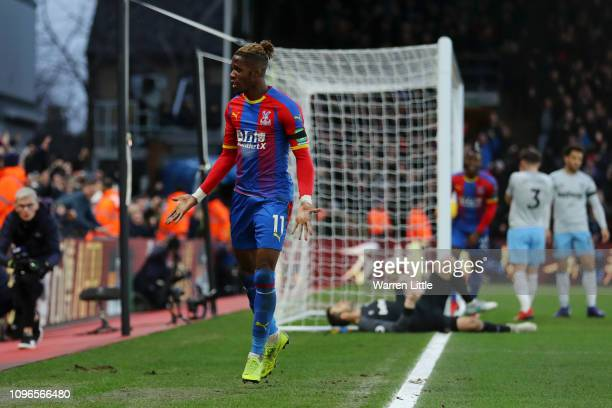 Wilfried Zaha of Crystal Palace celebrates after scoring his team's first goal during the Premier League match between Crystal Palace and West Ham...