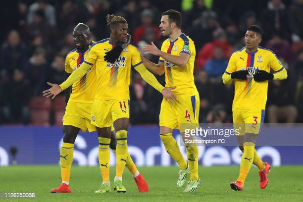 Wilfried Zaha of Crystal Palace celebrates after scoring his team's first goal with his team mates during the Premier League match between...