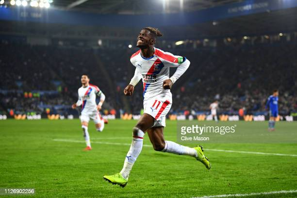 Wilfried Zaha of Crystal Palace celebrates after scoring his team's second goal during the Premier League match between Leicester City and Crystal...