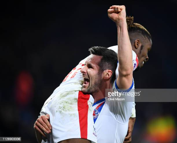 Wilfried Zaha of Crystal Palace celebrates after scoring his team's fourth goal with Scott Dann of Crystal Palace during the Premier League match...