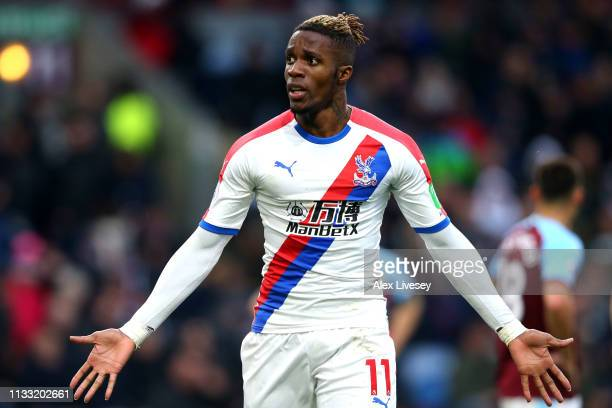 Wilfried Zaha of Crystal Palace celebrates after scoring his team's third goal during the Premier League match between Burnley FC and Crystal Palace...