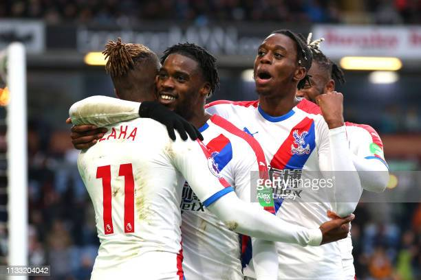 Wilfried Zaha of Crystal Palace celebrates after scoring his team's third goal with his team mates during the Premier League match between Burnley FC...