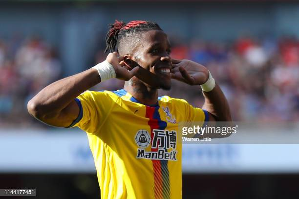Wilfried Zaha of Crystal Palace celebrates after scoring his team's second goal during the Premier League match between Arsenal FC and Crystal Palace...