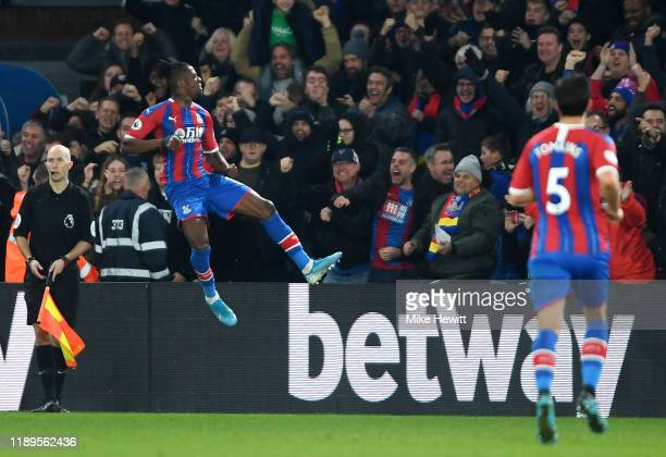 Wilfried Zaha of Crystal Palace celebrates after scoring his team's first goal during the Premier League match between Crystal Palace and Liverpool...