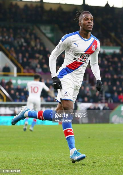 Wilfried Zaha of Crystal Palace celebrates after scoring his team's first goal during the Premier League match between Burnley FC and Crystal Palace...