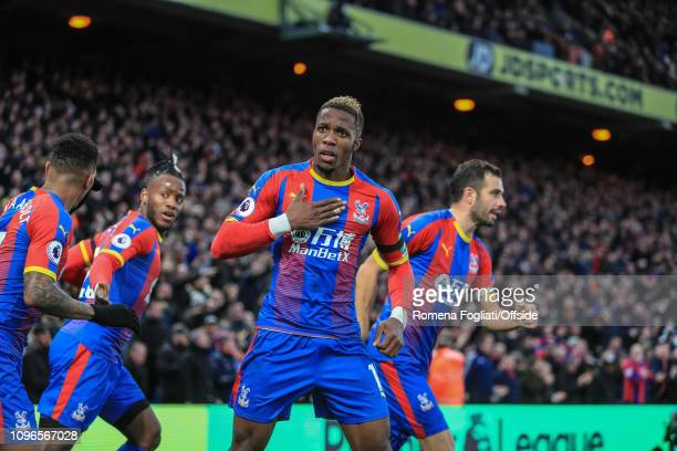 Wilfried Zaha of Crystal Palace celebrates after scoring their goal during the Premier League match between Crystal Palace and West Ham United at...