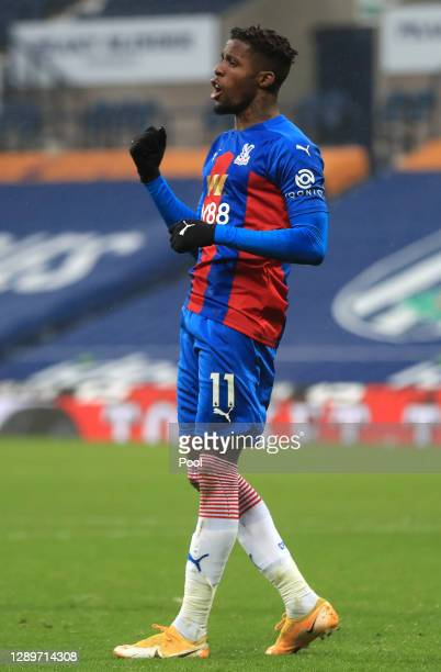 Wilfried Zaha of Crystal Palace celebrates after scoring their sides fourth goal during the Premier League match between West Bromwich Albion and...