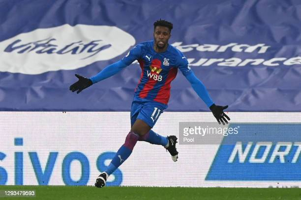 Wilfried Zaha of Crystal Palace celebrates after scoring their sides first goal during the Premier League match between Crystal Palace and Leicester...
