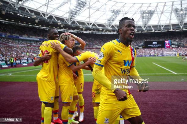 Wilfried Zaha of Crystal Palace celebrates, as Conor Gallagher of Crystal Palace celebrates with teammates after scoring his team's second goal...
