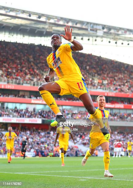 Wilfried Zaha of Crystal Palace celebrates as he scores his team's second goal during the Premier League match between Arsenal FC and Crystal Palace...