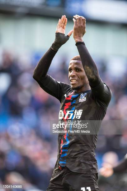 Wilfried Zaha of Crystal Palace celebrates during the Premier League match between Brighton Hove Albion and Crystal Palace at American Express...