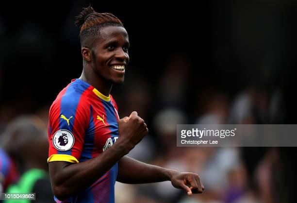 Wilfried Zaha of Crystal Palace celebrates following his sides victory in the Premier League match between Fulham FC and Crystal Palace at Craven...