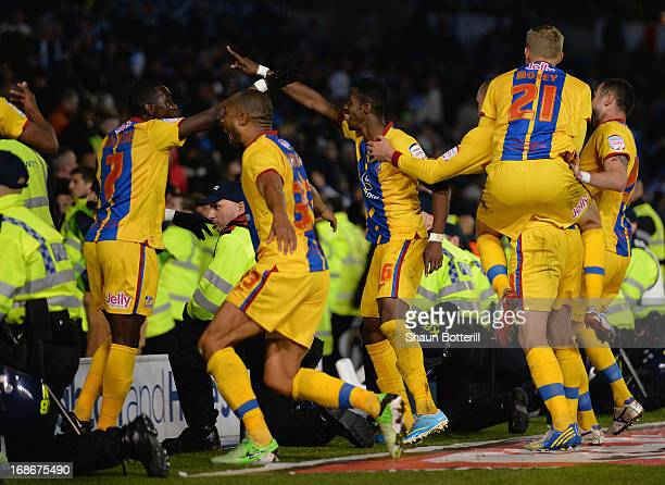 Wilfried Zaha of Crystal Palace celebrates his second goal amongst the police during the npower Championship play off semi final second leg between...