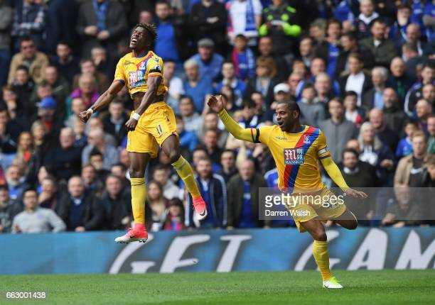 Wilfried Zaha of Crystal Palace celebrates scoring his sides first goal with Jason Puncheon of Crystal Palace during the Premier League match between...