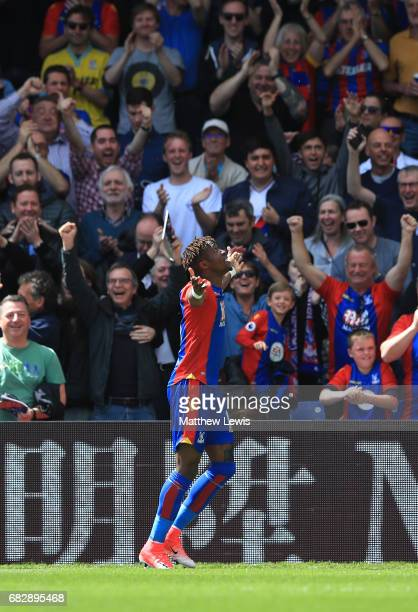 Wilfried Zaha of Crystal Palace celebrates scoring his sides first goal during the Premier League match between Crystal Palace and Hull City at...