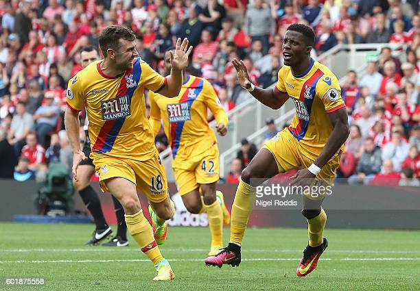 Wilfried Zaha of Crystal Palace celebrates scoring his sides second goal during the Premier League match between Middlesbrough and Crystal Palace at...