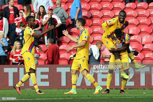 Wilfried Zaha of Crystal Palace celebrates scoring his sides second goal with Christian Benteke of Crystal Palace during the Premier League match...