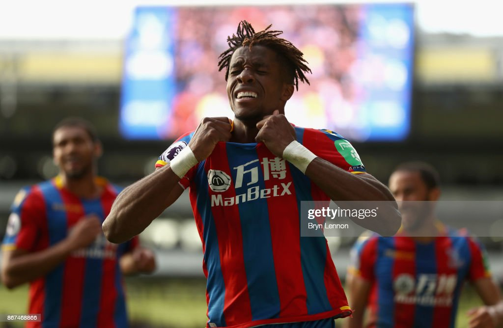 Wilfried Zaha of Crystal Palace celebrates scoring his sides second goal during the Premier League match between Crystal Palace and West Ham United at Selhurst Park on October 28, 2017 in London, England.