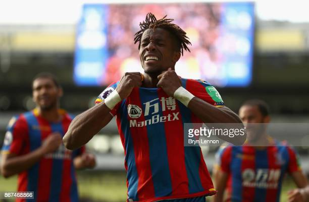Wilfried Zaha of Crystal Palace celebrates scoring his sides second goal during the Premier League match between Crystal Palace and West Ham United...