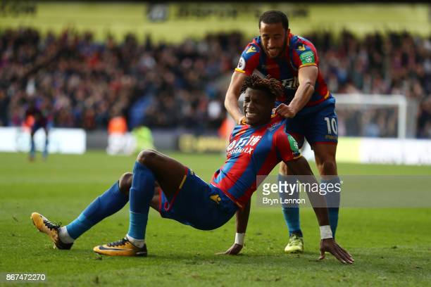 Wilfried Zaha of Crystal Palace celebrates scoring his sides second goal with Andros Townsend of Crystal Palace during the Premier League match...