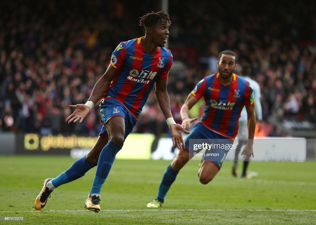 Wilfried Zaha of Crystal Palace celebrates scoring his sides second goal with Andros Townsend of Crystal Palace during the Premier League match between Crystal Palace and West Ham United at Selhurst Park on October 28, 2017 in London, England.