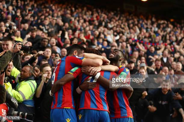 Wilfried Zaha of Crystal Palace celebrates scoring his sides second goal with his Crystal Palace team mates during the Premier League match between...